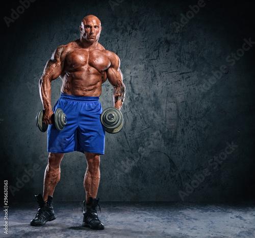 Fototapeta  Hard Core Bodybuilding. Bodybuilder Lifting Weights