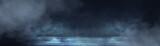 Fototapeta Abstract - Dark street, wet asphalt, reflections of rays in the water. Abstract dark blue background, smoke, smog. Empty dark scene, neon light, spotlights. Concrete floor