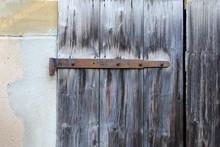 Old Rusty Hinge On Old Wooden Door