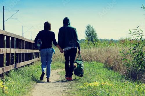 Foto auf Gartenposter Olivgrun couple walking in the park, couple of tourists in Poland