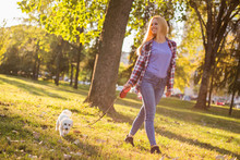 Beautiful Woman Walking With H...