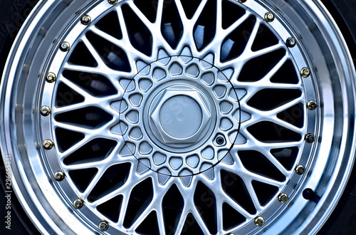 Close up flat view of a perfect alloy rim, example of car industry aftermarket car trimming parts business Wallpaper Mural