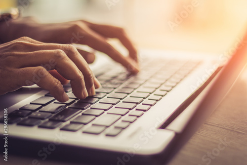 Fotografía  Woman using laptop, searching web, browsing information, having workplace at home
