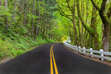 A Winding Road Along The Columbia River Scenic Byway With The Classic White Fencing In Oregon