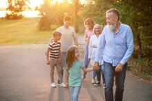 Big Family Walking In Park