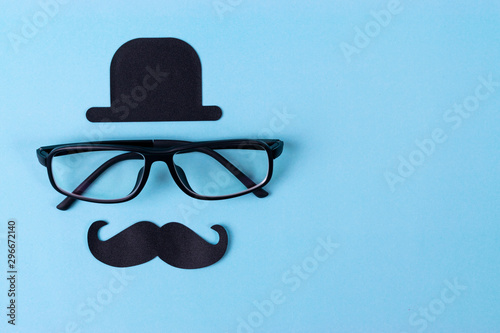 Photo Movember mustache awareness background with  glasses.