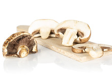 Group Of One Whole Two Halves One Slice Of Fresh Brown Mushroom Champignon On Wooden Cutting Board Isolated On White Background