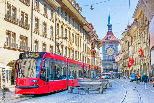 Streets with shopping area and Zytglogge astronomical clock tower and fountain in the historic old medieval city centre of Bern, Switzerland