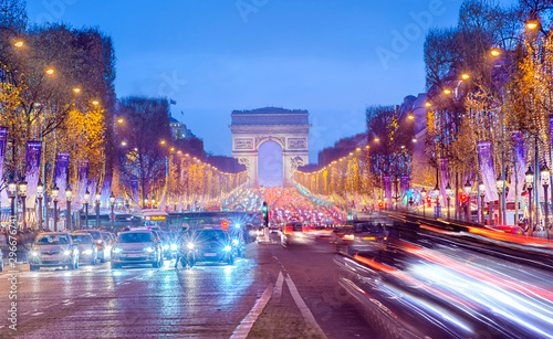 Arch of Triumph and Champs Elysees in Paris at night, France Tableau sur Toile