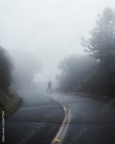 Fototapety, obrazy: Man hiking through dense cold fog