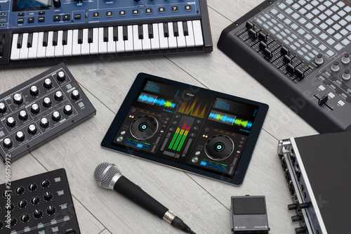 Mixing music on tablet with electronic music instruments concept - 296679972