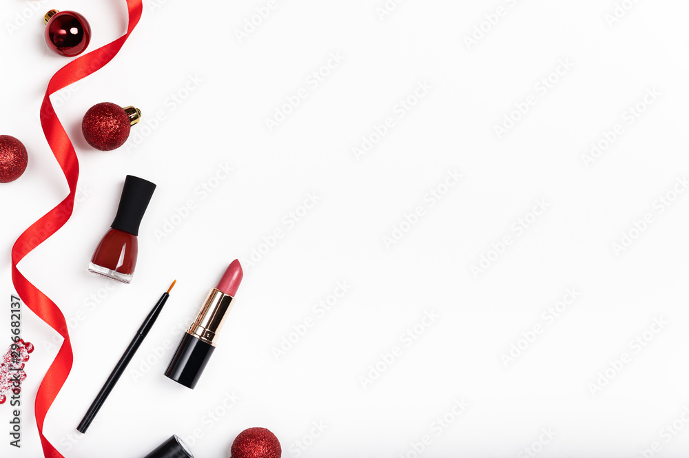 Fototapety, obrazy: Red lipsticks and nail polish top view composition. Beauty industry product concept. Makeup accessory on white background. Women pomade. New Year, Christmas present idea. Cosmetology attribute