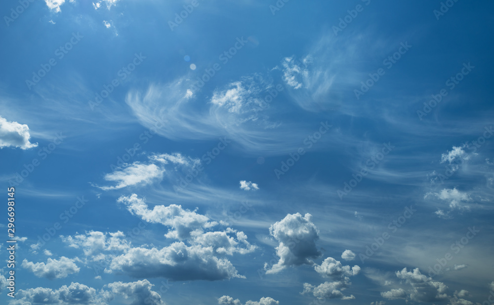 Fototapety, obrazy: Some light cumuliform and cirrus clouds in the clean blue sky.