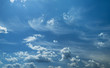 Leinwandbild Motiv Some light cumuliform and cirrus clouds in the clean blue sky.