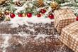 Leinwandbild Motiv Festive gift with bow close up on wooden background with snow