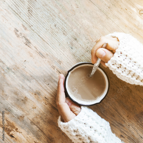 Spoed Foto op Canvas Chocolade Closeup hands stirring coffee in mug