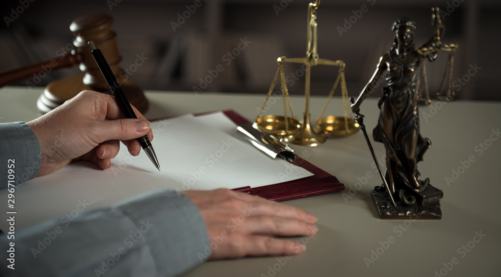 Fototapety, obrazy:  A lawyer working at a desk in a courtroom