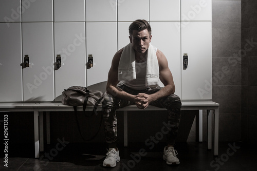 Fotografiet  Serious sportsman in gym changing room