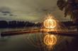 canvas print picture - Lichtkunst am Bootssteg am See