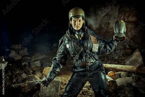 Valokuva  Soldier woman with the bomb on post apocalyptic background.