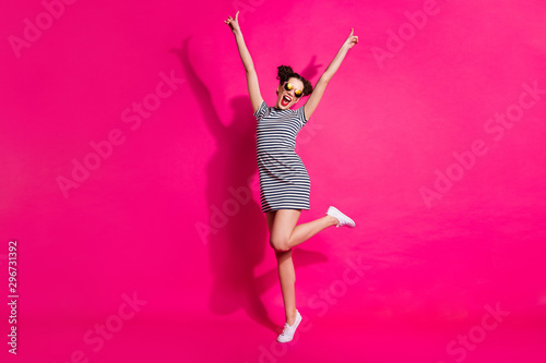Full length body size view of her she nice attractive lovely cheerful cheery girl dancing having fun rising hands up isolated over bright vivid shine vibrant pink fuchsia color background - 296731392