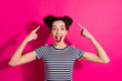 canvas print picture - Photo of trendy cheerful cute nice curly charming fascinating pretty sweet youngster pointing at her hair bun shocked wearing striped t-shirt isolated over pink bright color background