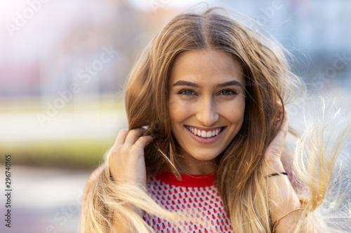 Fototapeta Portrait of beautiful young woman outdoors  obraz