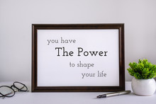 Wood Frame With Inspirational And Motivational Wisdom Quote.