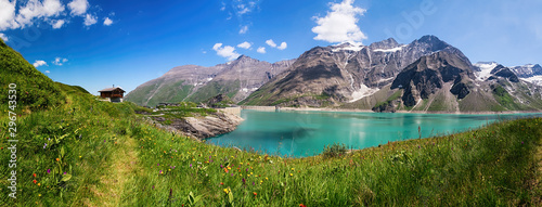 Fototapeta Panoramic view of Reservoir Mooserboden embedded in the impressive mountains of the Hohe Tauern near Kaprun, Austria. obraz