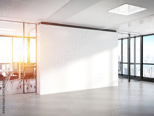 Obraz Blank white wall in concrete office with large windows Mockup 3D rendering - fototapety do salonu