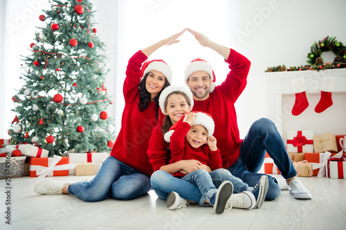 canvas print motiv - deagreez : Portrait of four nice attractive lovely sweet idyllic affectionate cheerful big full careful family brother sister celebrating newyear leisure showing roof in light white interior living-room