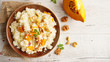 Leinwandbild Motiv pumpkin risotto with walnut and cheese, top view