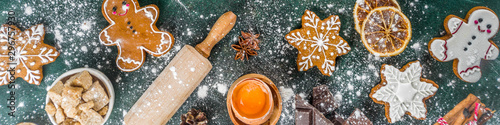 Christmas, New Year cooking background. Baking ingredients and utensils - flour, rolling pin, gingerbread, milk, eggs. Making festive Christmas sweet cookies. Top view copy space - 296757930