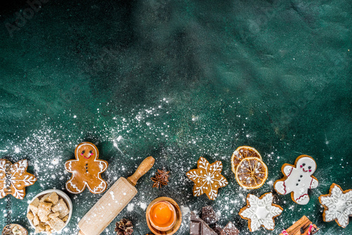 Fototapeta Christmas, New Year cooking background. Baking ingredients and utensils - flour, rolling pin, gingerbread, milk, eggs. Making festive Christmas sweet cookies. Top view copy space obraz