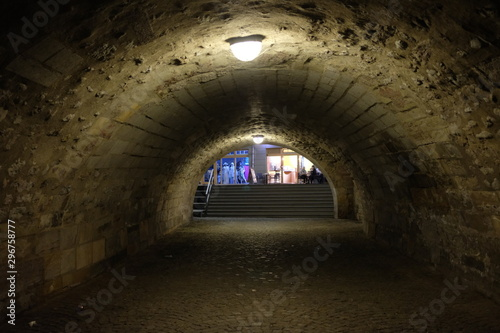 Garden Poster Old building Illumimated spooky stone tunnel in Erfurt at night