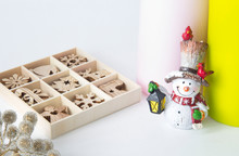 The Candles Are Different, The Snowman Doll And A Set Of Christmas Wooden Toys