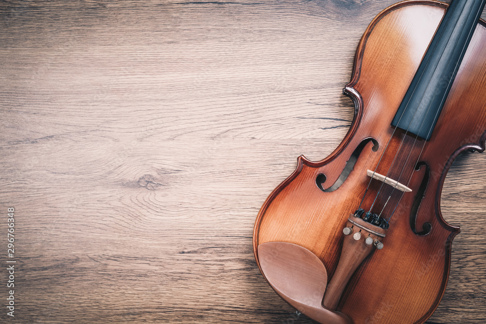 Fototapeta classical violin on wooden floor. music background