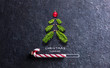 canvas print picture - Christmas Card - Loading Concept - Tree And Candy Canes On Black Stone