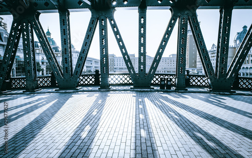 Fototapeta most   the-road-bridge-with-all-steel-beams-in-the-sunlight-has-clear-steel-beam-shadow-on-the-road