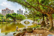 Wonderful Green Garden And Scenic White Bridge Over Lake, Taipei