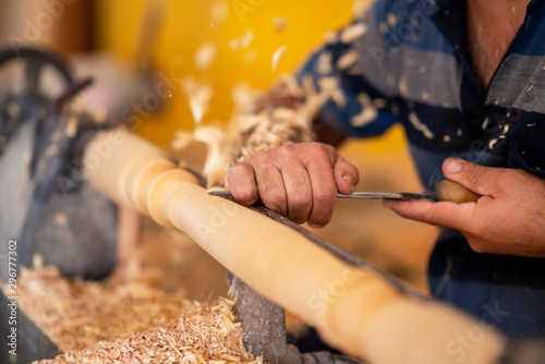Carpenter working on wood to carving and shaping Fotobehang
