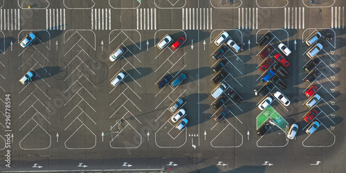 Fotografía  Aerial view of parking with many cars near the business center and supermarket