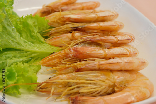 closeup boiled shrimps with lettuce on plate. Wallpaper Mural