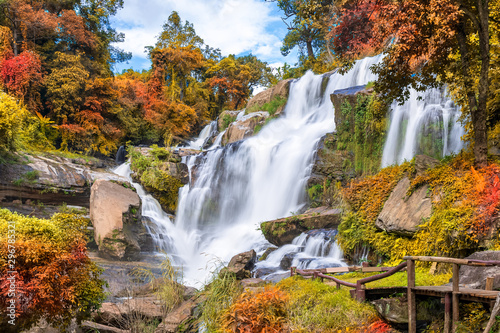 Obraz Colorful majestic waterfall in national park forest during autumn - fototapety do salonu