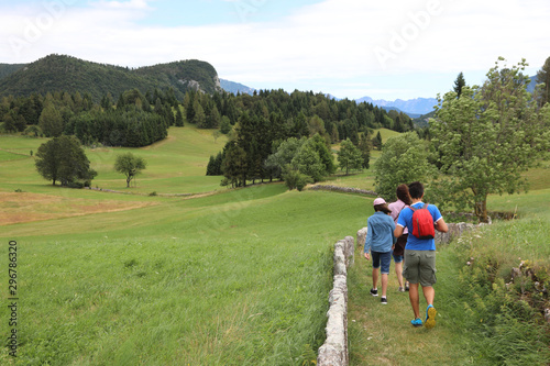 Vászonkép family on the hiking track in mountain