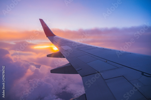 Beautiful sunset, sky on the top view, airplane flying view from inside window aircraft of Traveling. - 296786762