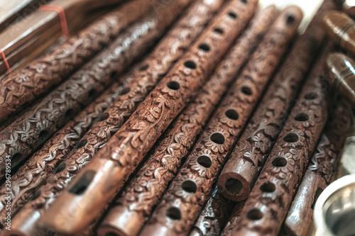 Obraz na plátne Row of Bansuri, traditional flute instrument from India
