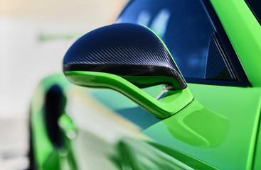Detail of super sports car carbon fiber rearview mirror.