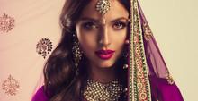 Portrait Of Beautiful Indian Girl . Young Hindu Woman Model  In Sari And  Kundan Jewelry . Traditional India Costume Lehenga Choli . Eastern Or Arabic Culture.