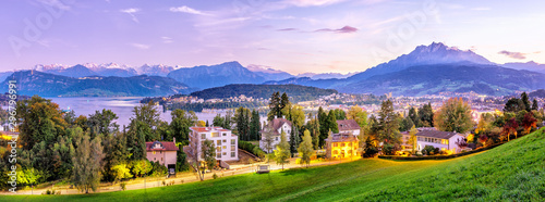 Montage in der Fensternische Landschaft Switzerland, Lucerne city. Panoramic view on downtown of Lucerne from the hill top near city conservatory. Aerial view during twilight. Picturesque city landscape. Autumn season.